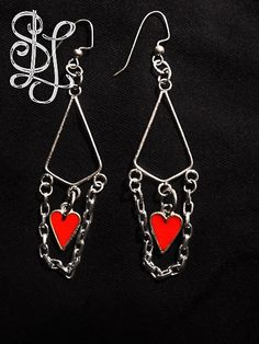 "Heart Tangle Earrings (from the Jeunesse Collection) feature silver dangle chains and  red heart pendants in a 3"" design. $12 at Sasha L Jewels LLC. #earrings #jewelry #fashion"
