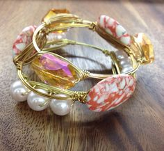 The Giana Stacklette Set by FancyStacks on Etsy, $38.50. A set of 3 wire wrapped bangles. Available in Gold, Rose Gold or Silver. Standard and Custom Sizes available. The perfect, unique gift for bridesmaids, maid of honor, mothers day, birthdays and any special occasion.