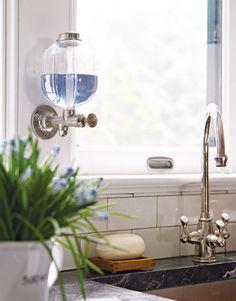 In The Main Kitchen, A Polished Nickel Franke Triflow Corinthian Faucet.    HouseBeautiful.com