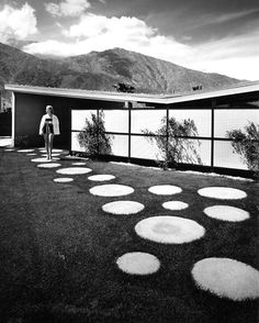 Modernism for the Masses - Blogs - Dwell (Butterfly Roof and really cool round pavers).
