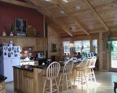 The kitchen in a milled log home I designed in Indiana many years ago.  #loghomes #loghomedesign #milledlog #kitchen  For more photos of this or more of my designs, please check out my website, www.designma.com, my Design Page, www.facebook.com/loghomedesign, or Pinterest, http://www.pinterest.com/murrayarnott/murray-arnott-design