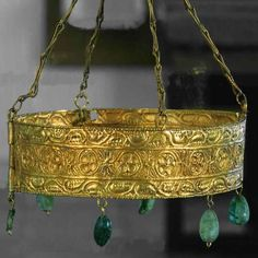 SPAIN - VISIGOTH CROWN. 7th century. Embossed gold, precious stones. The Treasure of Guarrazar is an archeological find composed of votive crowns and crosses offered to the Roman Catholic Church by the Kings of the Visigoths in the seventh century in Hispania.