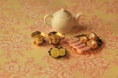 Tea cups from small bells and saucers from tacks