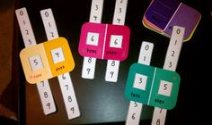 Sliding Place Value Cards- cut 2 slits in each side of paint chip cards to fit long slip of paper with numbers 0-9.