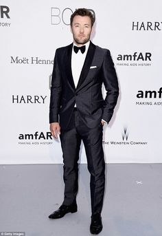 Very dapper: Joel Edgerton smartened up for amfAR's 23rd Cinema Against AIDS Gala in a classic charcoal tuxedo on Thursday night