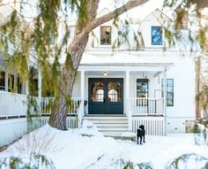 A New England Farmhouse in the Snow | front door paint color