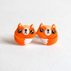 Those super cute Fox earrings are handmade with polymer clay by myself, they are completely adorable! Nice gift for anyone! - Earring studs are stainless steel - Earrings measure 1,2 cm - All jewelry will come packed in their own little organza bag Other jewelry shown at the last photo is