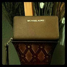 Wristlet Color: Luggage  Brand:Mk Wristlet  Used twice Michael Kors Bags Clutches & Wristlets