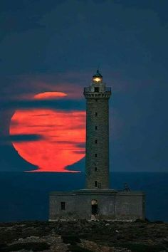 The Lighthouse of Ermoupolis illuminated and aligned with a huge red full moonrise, in Syros island, Cyclades, Greece Beautiful Moon, Beautiful Places, Beauty Dish, Cool Pictures, Beautiful Pictures, Lighthouse Pictures, Beacon Of Light, Red Moon, Water Tower