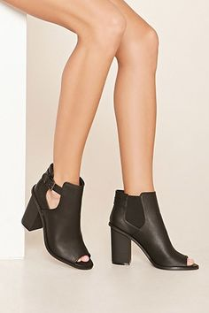 1f704965a385 This pair of booties features side cutouts with a buckle closure  stepitup Bootie  Boots