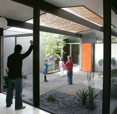 """Eichler homes were ahead if their time. Kids could play outside while still actually being """"inside"""" the house.  Enjoying the atrium (an Eichler home)"""