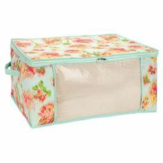 """Canvas storage bag with an ikat floral motif and see-through panel.   Product: Storage bagConstruction Material: CanvasColor: Teal, pink and green Features: See-through side panel Dimensions: 12"""" H x 24"""" W x 18"""" D"""