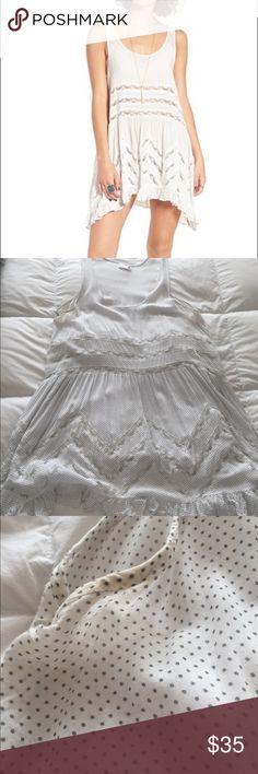 FP Slip White slip with lace detail. Discoloration showed in pics in arm holes. I do not trade. Sold as is. Free People Tops