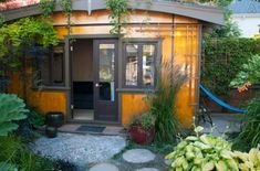 Exterior of the garden guest house, Portland. I love this roof line and t he contrasting colors of the woods. Charming!