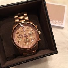 Michael Kors Rose Gold watch Authentic Michael Kors Rose Gold watch. Comes with box, extra links and instruction booklet. Beautiful watch...I don't wear it enough so I want to find it a new home. Willing to negotiate! MICHAEL Michael Kors Accessories Watches