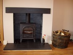 A Stovax Stockton 5 stove with Riven slate beam , hearth and a split faced slate chamber.