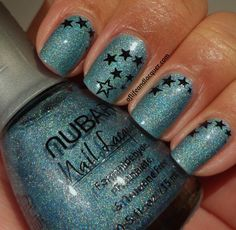 Nubar Absolute     Color: Absolute is a bold turquoise with a holographic glitter.    This is reminiscent of sparkling lagoons and is perfect for summer.  http://www.butikbutik.dk/collections/nubar/products/nail-polish-absolute