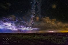 Epic Milky Way Lightning Storm  While in Amarillo Texas I was set up for some storm chasing when a few breaks in the clouds allowed the Milky Way to peep through so I set up a time lapse of the storms rolling through as the Milky Way slowly crept across the sky behind them. I used multiple images to piece together one composite of the storms and the Milky Way. I hope you enjoy!  Camera: Canon EOS 5D Mark III Shutter Speed: 25sec ISO/Film: 5000  Image credit: http://ift.tt/2aEXD4a Visit…