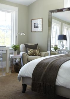 Love this soothing palate for a guest bedroom.  Easy to source elements: parson's desk, ghost chair, garden stool, large mirror, etc.