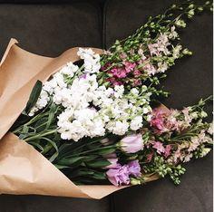 beautiful flowers in brown paper