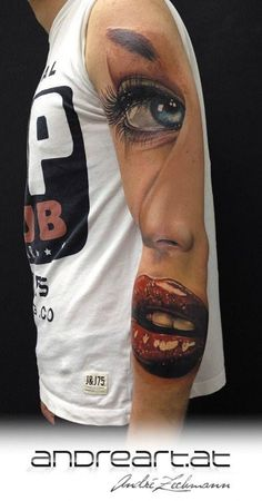 face on arm tattoo