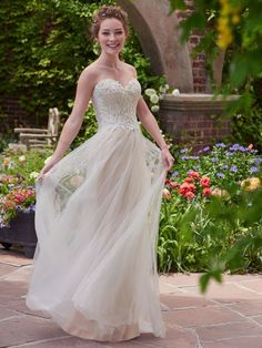 This is such a pretty wedding dress, so whimsical and romantic. Chelsea   Rebecca Ingram by @maggiesottero
