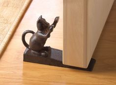 Cast iron door stopper with cat figurine. He may be using your door as a scratching post, but he'll be a welcome addition to your home. Use him to prop open the door as you carry groceries inside or t