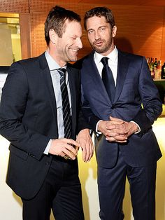 DASHING DUO photo   Aaron Eckhart, Gerard Butler at a gala dinner in honor of their film Olympus Has Fallen - in Rome