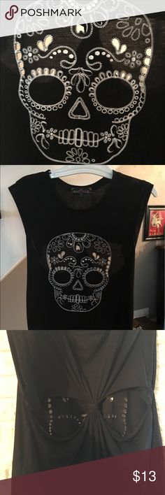 Skull tank with cutouts! Black asymmetrical (back longer) tank with racerback like back; perfectly placed cutouts on skull face. Worn once. Almost Famous Tops Tank Tops