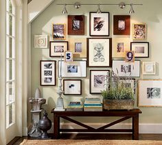 love this foyer. ditto. i like that the frames don't match and the chunky, dark bench offsets the lightness of the space.
