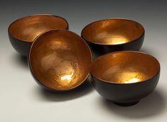 Sake cups i engraved, raised, then enameled.