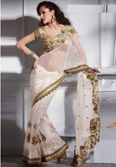 "Click on image to zoom or click to enlarge Cream Shiffon & Net Astonishing Worked Saree Designed with Semi Stitch Blouse  INR:-6870 Only (With Discount 25% !! Use Coupon Code ""FLAT 25″ To Avail The Discount)"
