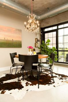 this cow hide rug brings the look of this dining room together.