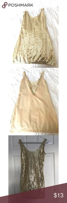 Gold Sequins Dress Never Worn! This is a dress. Can be worn with leggings, panty hose, stockings, etc. However desired. Great for dance outfits, party goers, or any special/fun occasion. Dresses