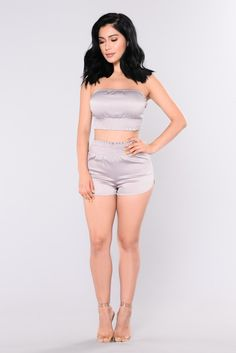 Available In Mauve 2 Piece Set Satin 96% Polyester, 4% Spandex Top: Tube Top Smocked Hemline Cropped Shorts: Smocked Waist High Rise