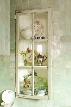another great way to use a window frame ~ I love this! I've seen this look in old houses! :D <3