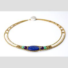 Nu round lapiz necklace by ziio. Composed with iron wire, semi-precious stones: amethyst, chrysophrase, silver, brass murano glass beads and water pearls.