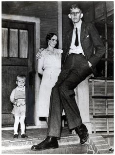 May 1936, Robert Wadlow at 18 years old with his mother and brother Harold Jr.  is the tallest person in medical history for whom there is irrefutable evidence.  Robert Wadlow reached 8 feet 11.1 inches (272 cm) in height and weighed 490 pounds (220 kg) at his death. His great size and his continued growth in adulthood was due to hypertrophy of his pituitary gland which results in an abnormally high level of human growth hormone.