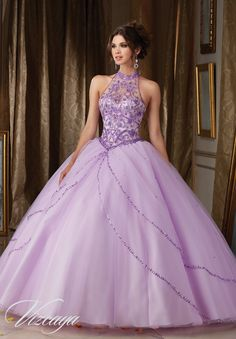 Quinceanera dresses by Vizcaya Jeweled Beading on Princess Tulle Ball Gown Matching Bolero Jacket. Available in Light Purple, Blush, Bahama Blue, White