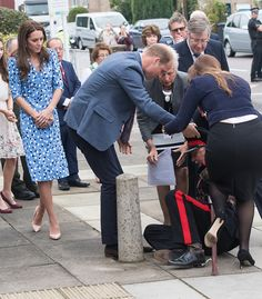 Catherine, Duchess of Cambridge looks on as Prince William, Duke of Cambridge helps up Jonathan Douglas-Hughes, vice Vice Lord-Lieutenant of Essex after his fall at Stewards Academy on September 16, 2016 in Harlow, England.