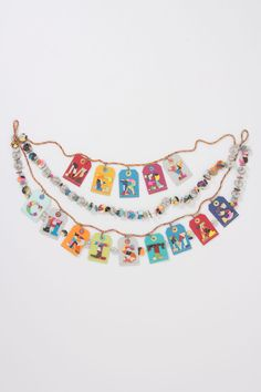 Cozy Collage Christmas Garland - Anthropologie.com