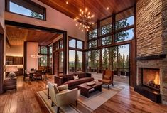 Rustic Living Room with Pella Custom Floor to Ceiling Window, Hardwood floors, Sunpan Malibu Wing Back Leather Chair