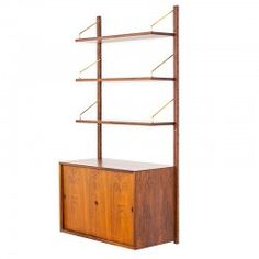 Modular Wall System by Poul Cadovius, 1960s. Vintage Danish rosewood wall-unit, designed by Poul Cadovius for CADO. The cabinet with sliding doors and the shelfs can be installed anywhere along the wall mounted uprights.This modular wall-unit is in great condition with minimal userwear. Shipping world wide.  Key features: •Rosewood. •Brass shelf brackets.  http://www.retrorevolution.nl/products/214-cadovius-rosewood.html