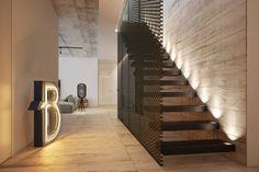 escalier suspendu en bois et tôle perforée et revêtement de sol en bois dans le loft industriel