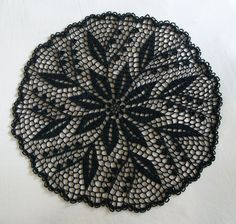 Gothic Crochet Lily-of-the-Valley Doily in Black Thread by Acadian Crochet, via Flickr