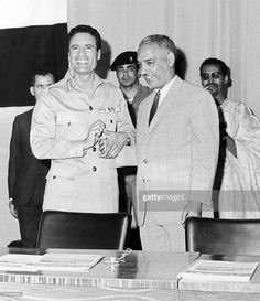Post 1969 picture of Libyan Head of State Colonel Moamer Kadhafi (L) shaking hands in Tripoli with the President of Mauritania (1961-78), Mokhtar Ould Daddah. Kadhafi, born in 1942, formed in 1963 the Free Officers Movement, a group of revolutionary army officers, which overthrew 01 September 1969 King Idris of Libya and proclaimed Libya, in the name of 'freedom, socialism and unity,' Socialist People's Jamahiriya.