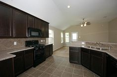 Summer Lakes Rosenberg TX: New Development Interior Kitchen with full granite and vaulted ceiling.  Developers include: Highland Homes, Plantation Homes, and  GreenEco Builders starting from 130k and up.