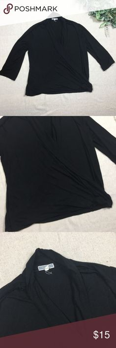 """Pleione 1X Black Faux Wrap Blouse Pleione 1X Black Faux Wrap Blouse. Normal wear and wash. No rips or stains.  Material: Rayon  Underarm to underarm 23"""" Top to bottom is 22"""" Pleione Tops Blouses"""