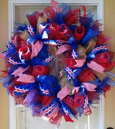 Very full, well-made wreath is made using four kinds of deco mesh for added fullness: natural stiff burlap mesh; red paper burlap; deluxe