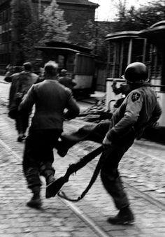 "itsjohnsen: "" A U.S. soldier kicks a German POW. Leipzig, 1945. Robert Capa """
